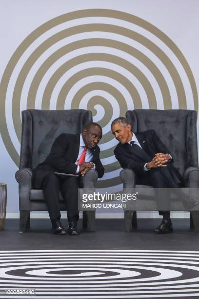 South African President Cyril Ramaphosa and former US President Barack Obama attend the 2018 Nelson Mandela Annual Lecture at the Wanderers cricket...
