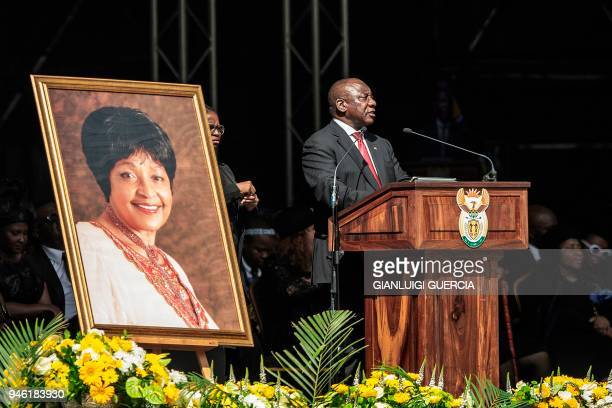 South African President Cyril Ramaphosa delivers the main eulogy as some 37500 mourners listen on at the Orlando Stadium in the township of Soweto...