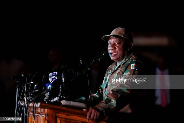 South African President Cyril Ramaphosa dressed in military fatigues talks to soldiers of the South African National Defence Force at the Doornkop...