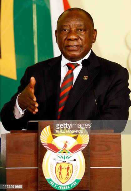 South African President Cyril Ramaphosa give a press conference during the official state visit of Nigeria's President in Pretoria on October 3 2019...