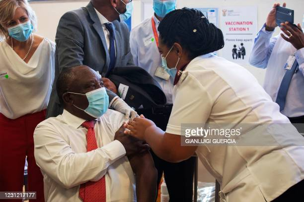 South African President Cyril Ramaphosa is inoculated with a Covid-19 vaccine shot at the Khayelitsha Hospital in Cape Town on February 17, 2021.