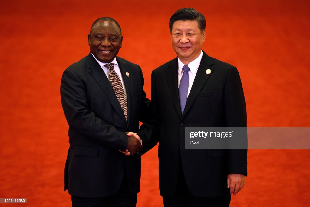 South African President Cyril Ramaphosa, left, shakes hands with Chinese President Xi Jinping during the Forum on China-Africa Cooperation held at the Great Hall of the People on September 3, 2018 in Beijing, China.