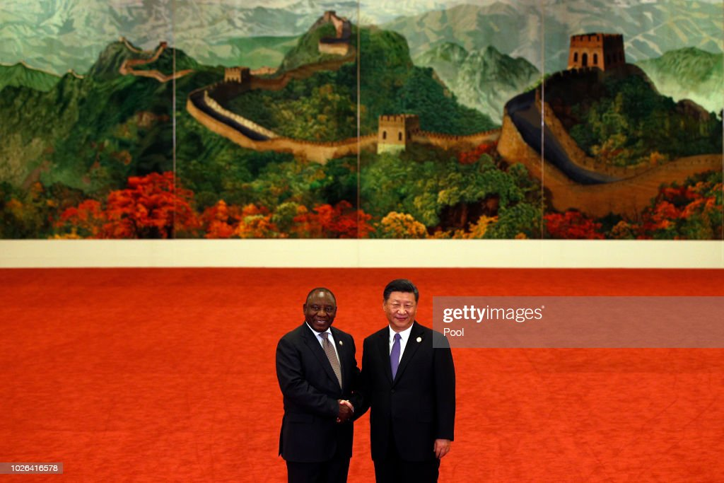 South African President Cyril Ramaphosa, left, shakes hands with Chinese President Xi Jinping as they pose for photographers during the Forum on China-Africa Cooperation held at the Great Hall of the People on September 3, 2018 in Beijing, China.
