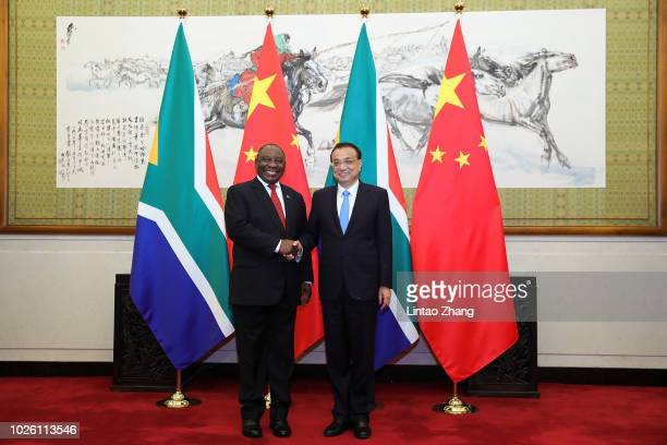 South African President Cyril Ramaphosa shakes hands with Chinese Premier Li Keqiang at Diaoyutai State Guesthouse on September 2, 2018 in Beijing,...