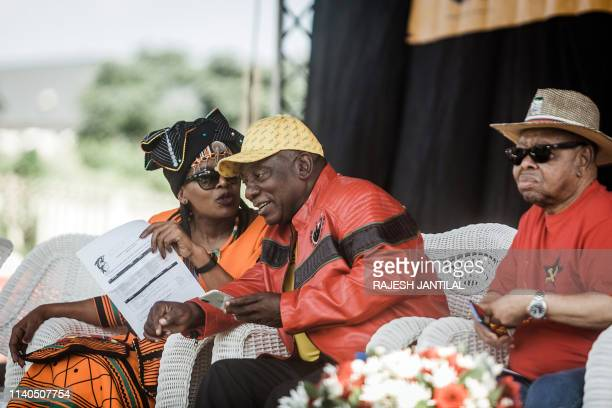 South African President Cyril Ramaphosa talks with Congress of South African Trade Unions President Zingiswa Losi as South African Communist Party...
