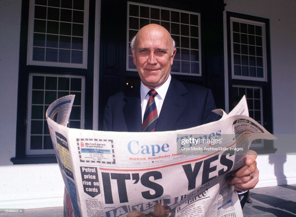 South African President FW de Klerk with a newspaper announcing results of the referendum - the country will go to the polls in a national election, Cape Town, South Africa, 17th March 1992.