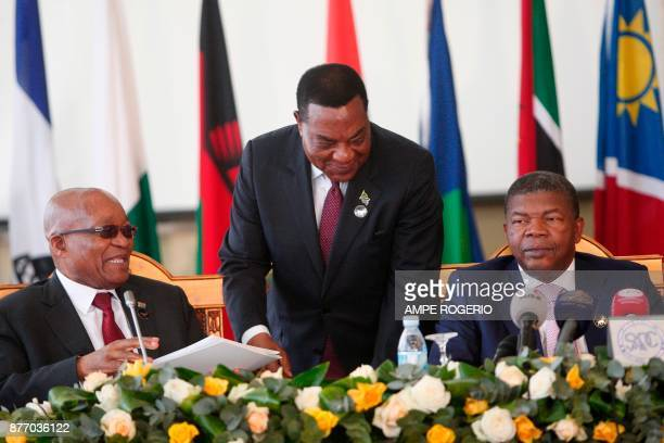 South African President Jacob Zuma and Angolan President Joao Lourenco attend a Southern African Development Community meeting on the Zimbabwe...