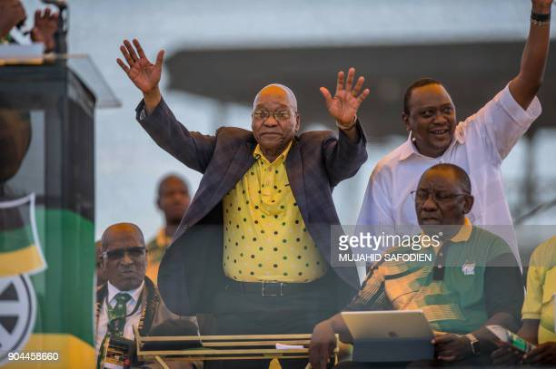 South African President Jacob Zuma and his Kenyan counterpart Uhuru Kenyatta wave at thousands of supporters at the Absa Stadium in East London...