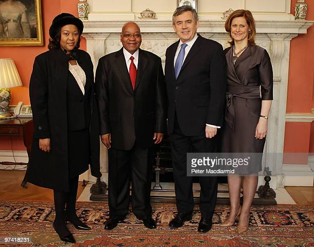 South African President Jacob Zuma and his wife Thobeka Madiba Zuma pose for a photograph with Prime Minister Gordon Brown and his wife Sarah Brown...