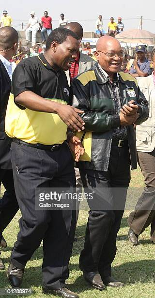 South African President Jacob Zuma and KwaZuluNatal Premier Dr Zweli Mkhize walk outside a rally held at the Ulundi C Section community hall on...