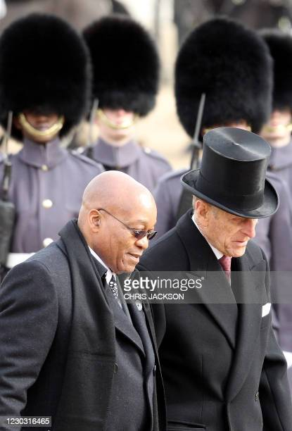 South African President Jacob Zuma and Prince Philip, the Duke of Edinburgh inspect the Honour Guard during a ceremonial welcome on Horseguards...