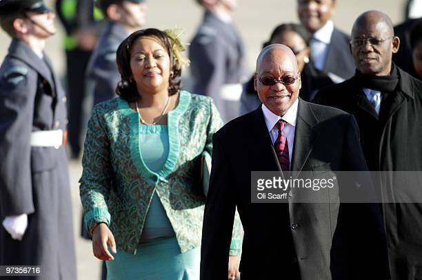 South African President Jacob Zuma and Thobeka Madiba Zuma his newest of three wives arrive at Heathrow airport on March 2 2010 in London England Mr...