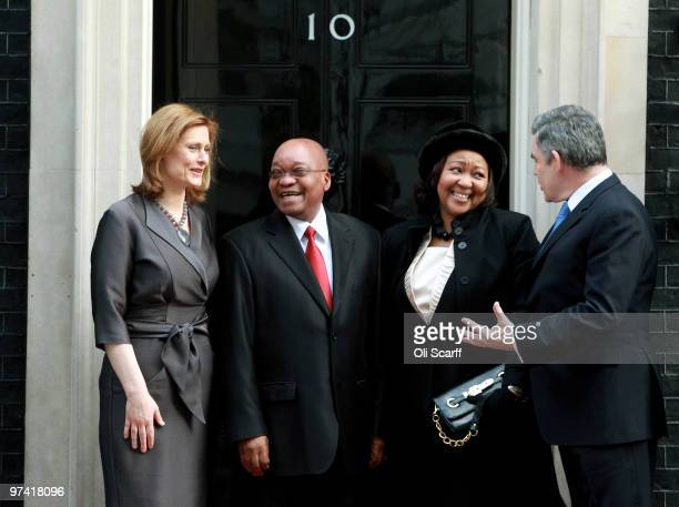 South African President Jacob Zuma and Thobeka Madiba Zuma his newest of three wives are greeted by British Prime Minister Gordon Brown and his wife...