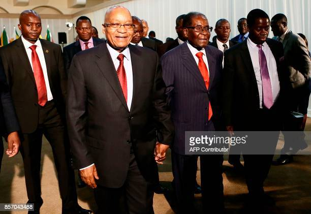 South African President Jacob Zuma and Zimbabwean President Robert Mugabe arrive to attend the 2nd Session of the South AfricaZimbabwe binational...