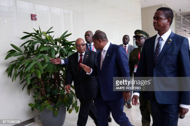 South African President Jacob Zuma Angolan President Joao Lourenco and Zambian President Edgar Lungu arrive to attend a Southern African Development...