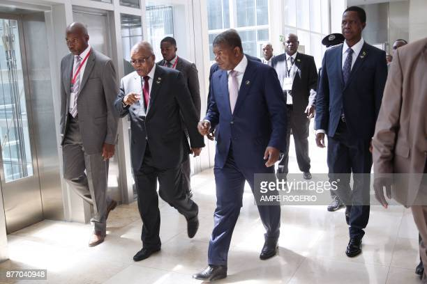 South African President Jacob Zuma Angolan President Joao Lourenco and Zambian President Edgar Lungu arrive to attend a Southern Africa Development...