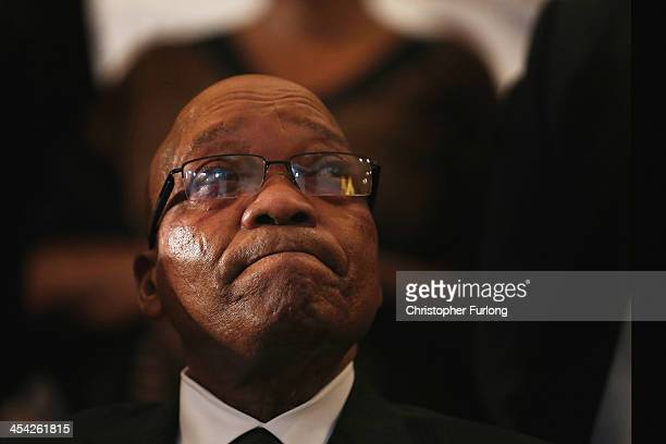 South African President Jacob Zuma attends a service at Bryanston Methodist Church during a national day of prayer, on December 8, 2013 in...
