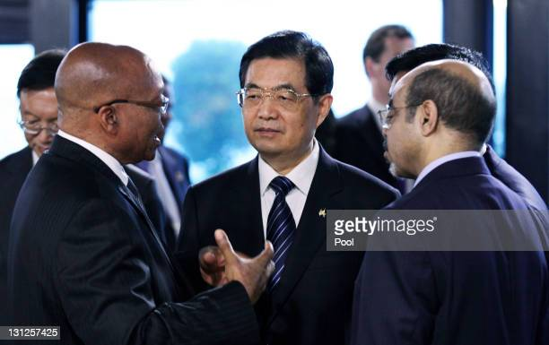 South African President Jacob Zuma China's President Hu Jintao and Ethiopian Prime Minister Meles Zenawi talk before the first working session at the...