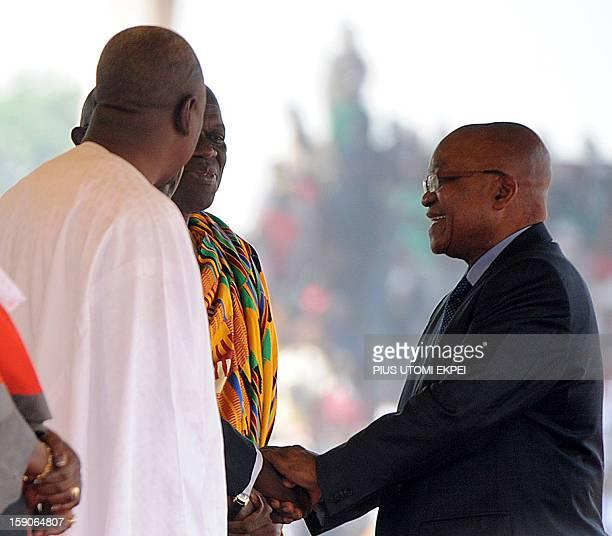 South African President Jacob Zuma congratulates Ghanaian President John Mahama and Vice President Kwesi AmissahArthur during their inauguration at...
