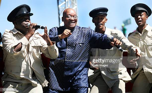 South African President Jacob Zuma dances during celebrations marking the 25th Anniversary of the Congress of South African Trade Unions on December...