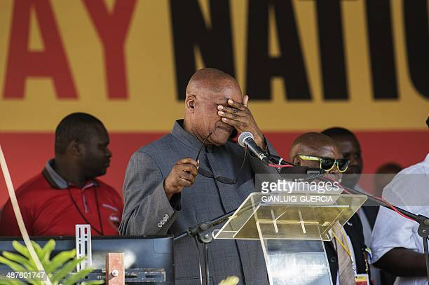 South African president Jacob Zuma gestures before addressing supporters at Peter Mokaba stadium in Polokwane during the Labour Day celebration an...