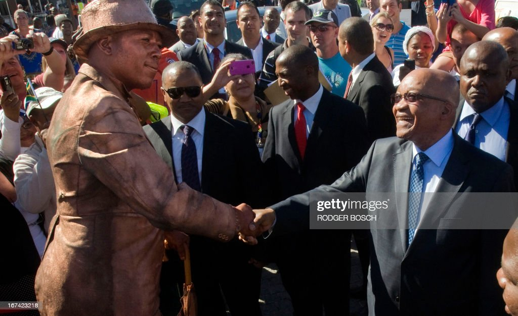 South African President Jacob Zuma (R) greets a mime during his announcement of the tourism figures for 2012 on April 25, 2013, in Cape Town. A record 9.2 million tourists visited South Africa last year, revealing a surge in visitors from China. China is now South Africa's fourth largest source of tourists, recording a 55.9 percent jump in the number of visitors.The number of tourists travelling to South Africa grew by more than 10 percent, despite the global economic crisis. Britons were the most frequent visitors, followed by the Americans and Germans. AFP / RODGER