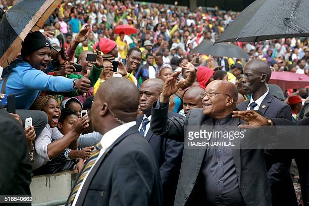 South African President Jacob Zuma greets people at the Moses Mabhida Football stadium in Durban as South Africa marks Human Rights Day on March 21...