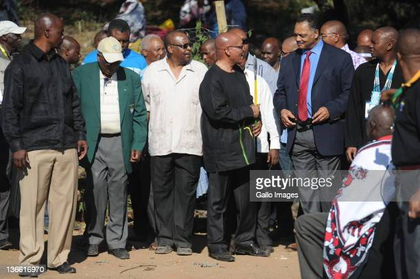 South African President Jacob Zuma holds a spear after the traditional slaughtering of an ox, part of an official cleansing and thanksgiving ceremony...