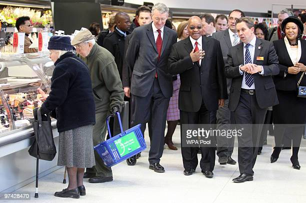 South African President Jacob Zuma Labour MP Hilary Benn and Justin King CEO of Sainsbury's walk around Catherine and John Przeslawski who were...