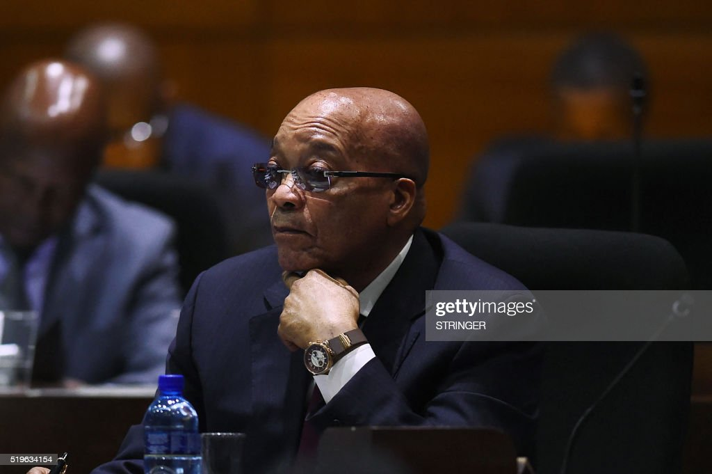 South African President Jacob Zuma listens to a speaker during the second sitting of the session of the fifth national house of traditional leaders at Tshwane Council Chambers in Pretoria on April 7, 2016. Zuma easily survived an impeachment vote on April 5 after a stormy session of parliament over a court ruling that he had violated the country's post-apartheid constitution. Lawmakers from Zuma's African National Congress (ANC) rallied to his defence, defeating the motion by 233 votes to 143 despite growing pressure for him to resign over the scandal. / AFP / STRINGER