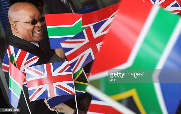 South African President Jacob Zuma meets the public during a visit to a Sainsburys supermarket in Greenwich southeast London on March 4 2010 British...