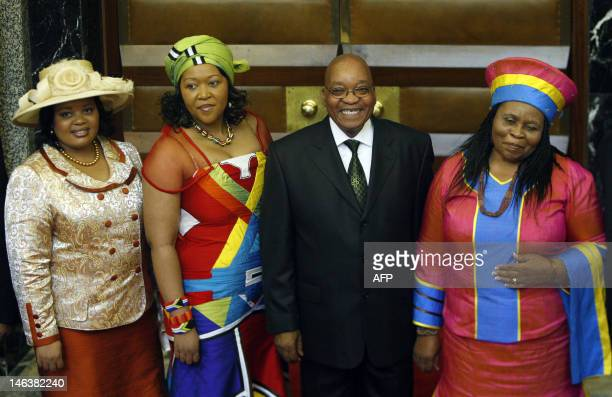 South African president Jacob Zuma poses for photographs with his three wives Sizakele Khumalo Nompumelo Ntuli and Thobeka Mabhija after the State of...