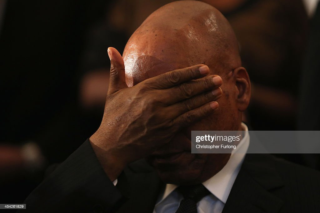 South African President Jacob Zuma rubs his eyes during a service at Bryanston Methodist Church during a national day of prayer, on December 8, 2013 in Johannesburg, South Africa. Mandela, also known as Madiba, passed away on the evening of December 5th, 2013 at his home in Houghton at the age of 95. Mandela became South Africa's first black president in 1994 after spending 27 years in jail for his activism against apartheid in a racially-divided South Africa
