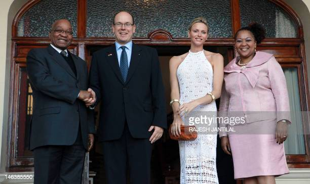 South African President Jacob Zuma shakes hands with Prince Albert of Monaco next to Monaco's Princess Charlene and South African First Lady Ma...