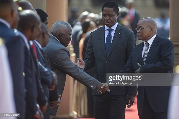South African President Jacob Zuma shakes hands with Zambia's deputies as he welcomes Zambia's President Edgar Lungu with official ceremony by South...
