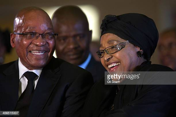 South African president Jacob Zuma shares a joke with with Winnie Mandela, a former wife of Nelson Mandela, during an African National Congress led...