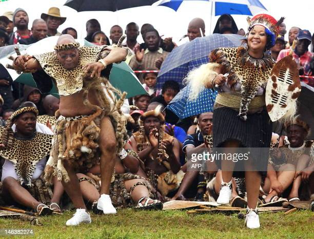 South African President Jacob Zuma sings and dances with his newlywed Tobeka Madiba at their wedding ceremony on January 4 2010 in a colourful Zulu...