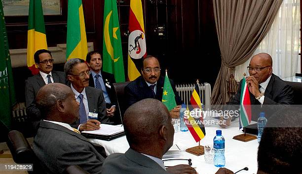 South African President Jacob Zuma sits next to his Mauritanian counterpart Mohamed Ould Abdel Aziz on June 26 2011 during an African Union panel...