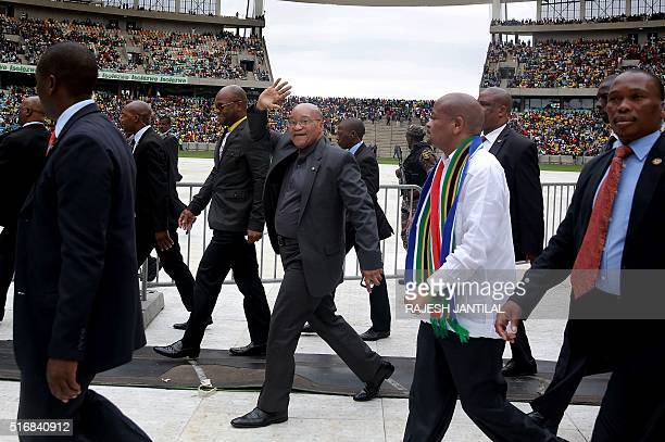 South African President Jacob Zuma waves as he arrives to the Moses Mabhida Football stadium in Durban as South Africa marks Human Rights Day on...