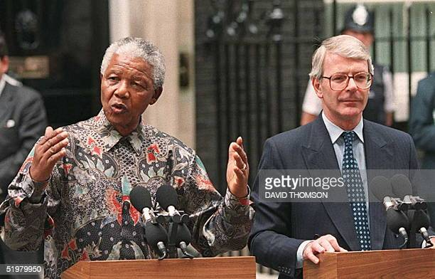 South African President Nelson Mandela and British Prime Minister John Major, talk with newsmen outside No 10 Downing Street on the second day of...
