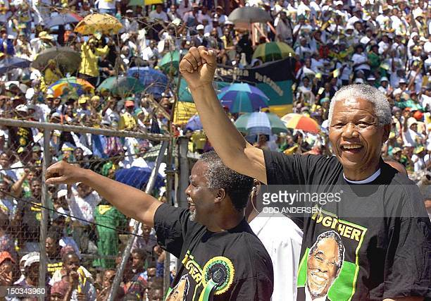 South African President Nelson Mandela and deputy President Thabo Mbeki greets the crowd from a pickup truck during an African National Congress...