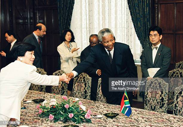 South African President Nelson Mandela and Japan's lower house chairperson Takako Doi shake hands at the Diet building on July 4 1995 in Tokyo Japan