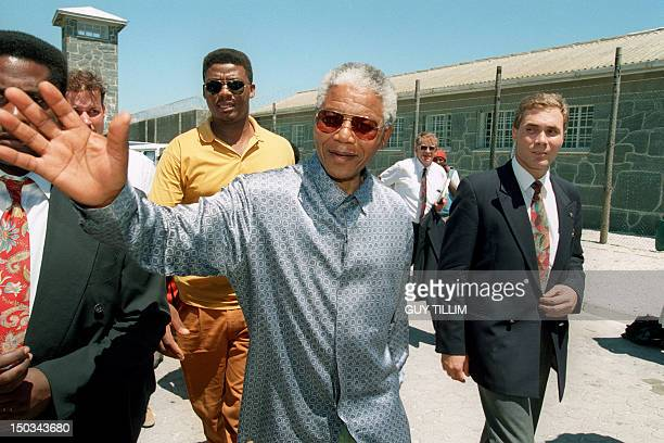 South African President Nelson Mandela arrives 10 February 1995 to visit the notorious Robben Island prison off the coast of Cape Town where he spent...