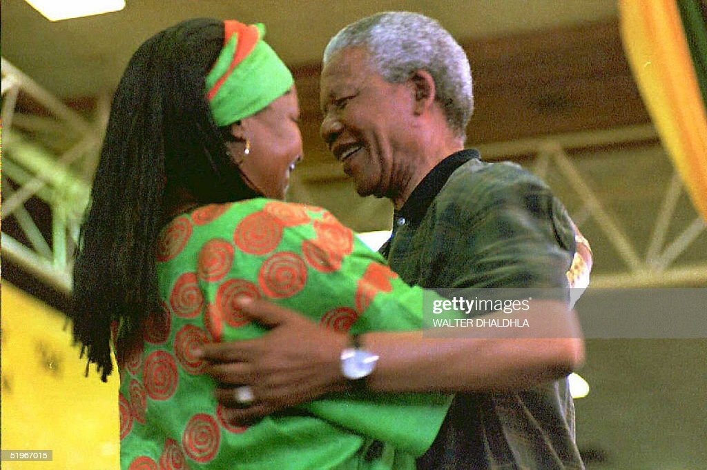 South African President Nelson Mandela (R) congratulates his wife Winnie after she has been elected to the National Executive Committee of the African National Congress (ANC) on the last day of its 49th constitutional congress in Bloemfontein, South Africa, 21 December 1994. The Mandela's have been seperated since 1992.