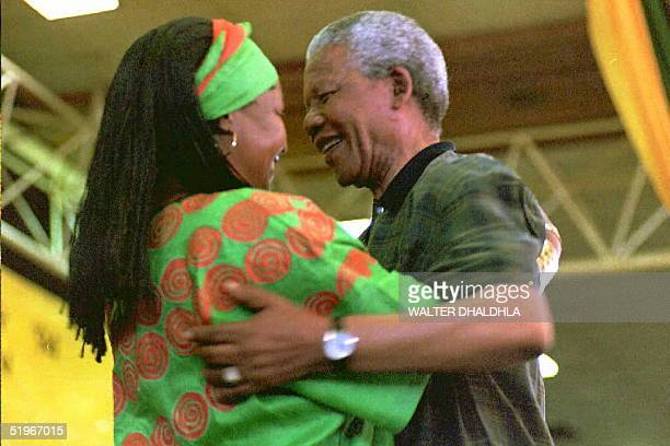 South African President Nelson Mandela congratulates his wife Winnie after she has been elected to the National Executive Committee of the African...