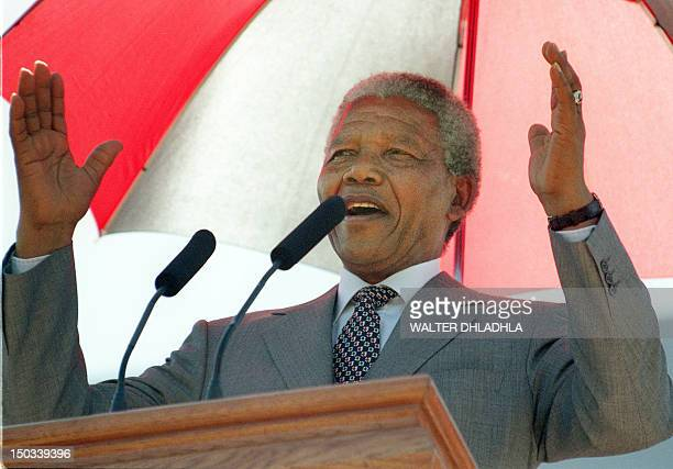 South African President Nelson Mandela greets some 10000 people gathered for Freedom Day celebrations on the lawn of the Union Buildings 27 April...