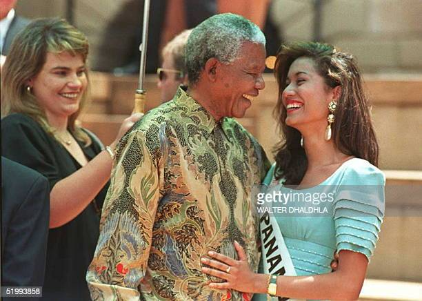South African President Nelson Mandela hugs with Miss Panama Marisela Moreno Montero during a photocall with 86 Miss World pageant candidates in...