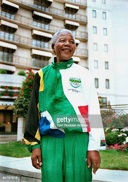 South African President Nelson Mandela outside the Dorchester Hotel in Park Lane, during a visit to London, July 1996. He is wearing a track suit in...