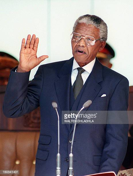 South African President Nelson Mandela takes the oath 10 May 1994 during his inauguration at the Union Building in Pretoria Mandela was elected...