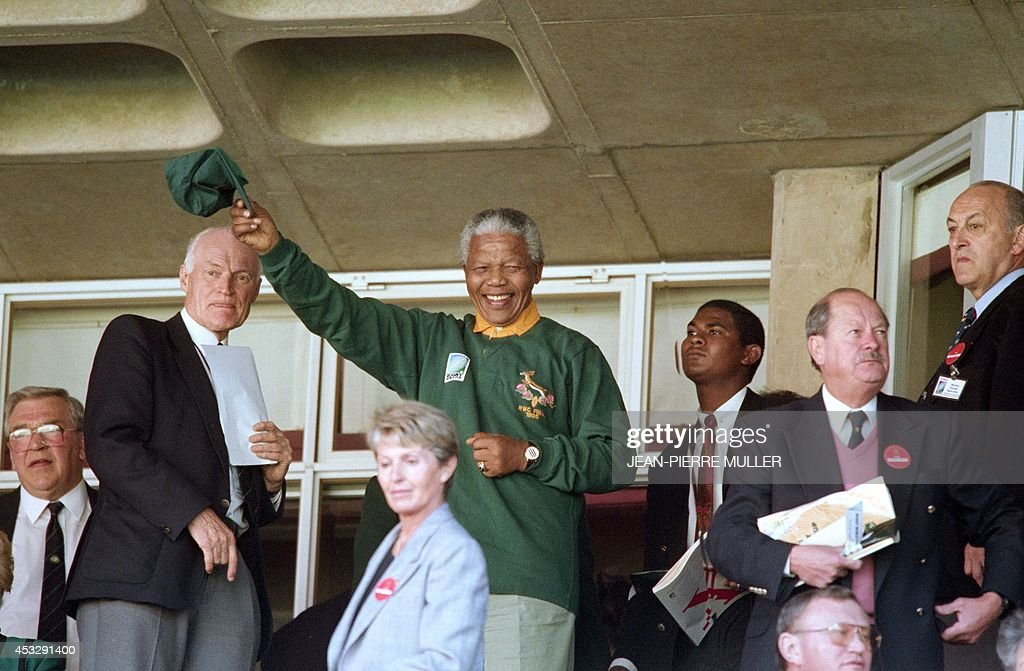 South African President Nelson Mandela wearing a Springbok jersey and cap waves upon arriving at Ellis Park in Johannesburg for the rugby World Cup final on June 24, 1995. Hosts South Africa play New Zealand.
